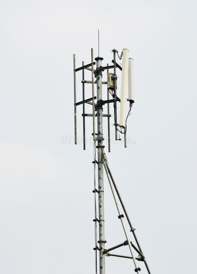 Antenna pole. The white antenna pole on white background stock image