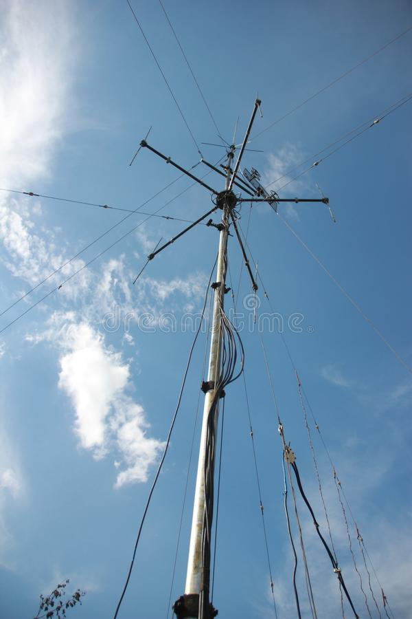 Antenna radio station against the blue sky stock images