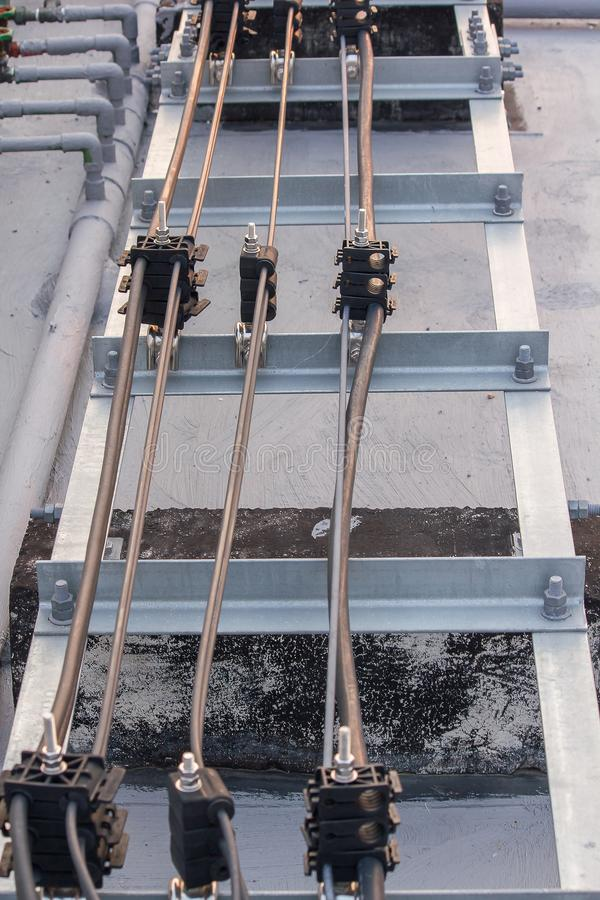 Antenna signal cable installed on the cement floor. Of the building royalty free stock photos