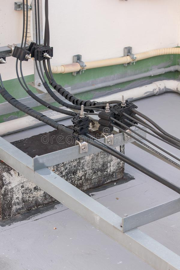 Antenna signal cable installed on the cement floor. Of the building royalty free stock images