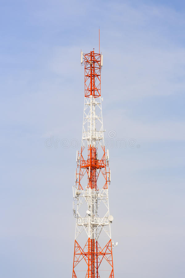 Antenna. Telecommunication antenna with blue sky background stock image