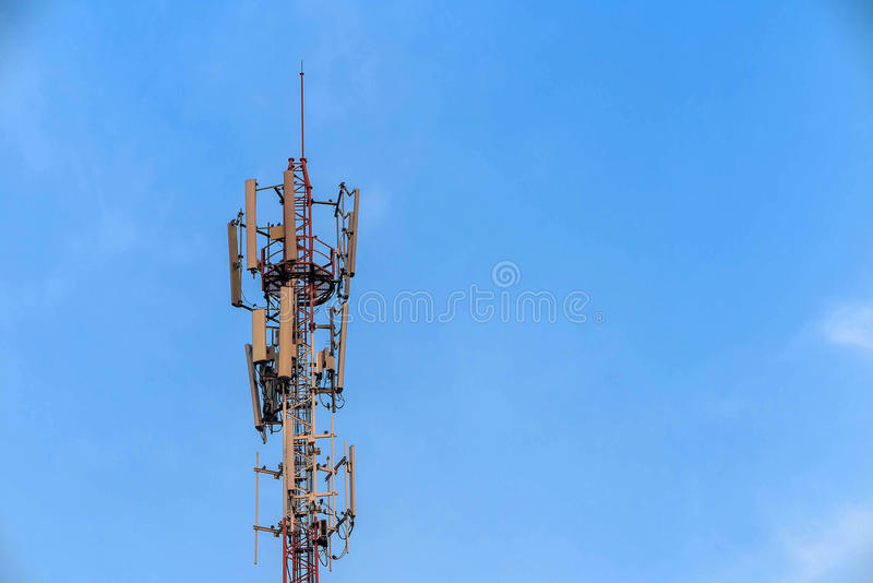 Antenna and telecommunication tower in blue sky. Background royalty free stock photo