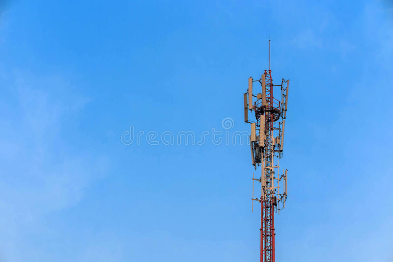 Antenna and telecommunication tower in blue sky. Background royalty free stock photos