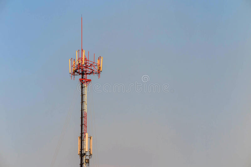 Antenna and telecommunication tower in blue sky. Background stock images