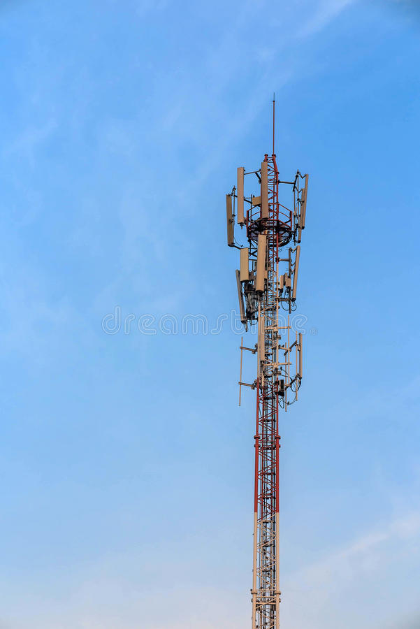 Antenna and telecommunication tower in blue sky. Background royalty free stock photography