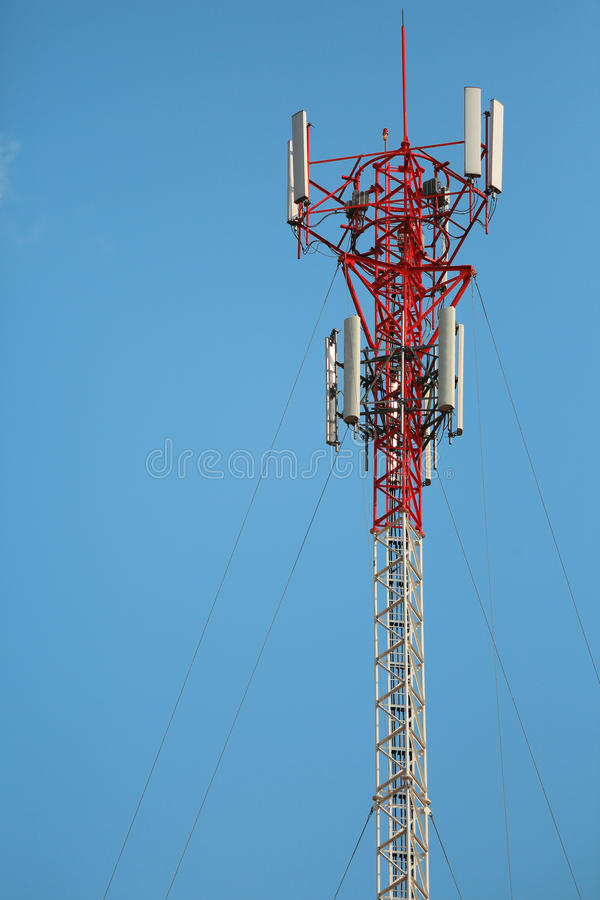 Antenna and telecommunication tower. In blue sky background stock photo