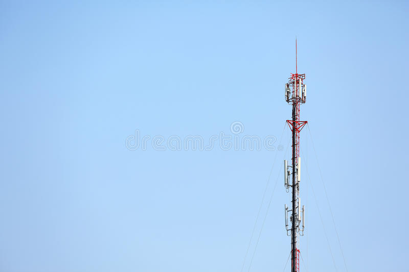 Antenna and telecommunication tower. In blue sky background stock photography