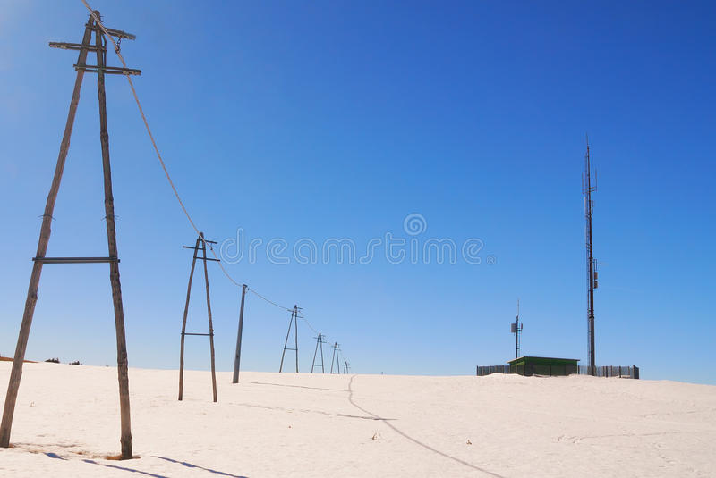 Antenna for telecommunications in snowy countryside royalty free stock photos