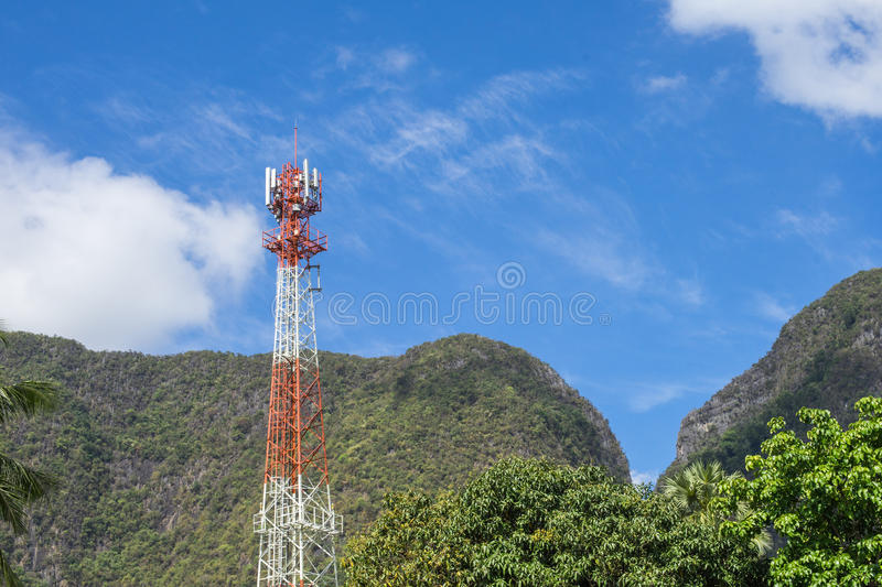Antenna tower with blue sky and mountain background. stock photos