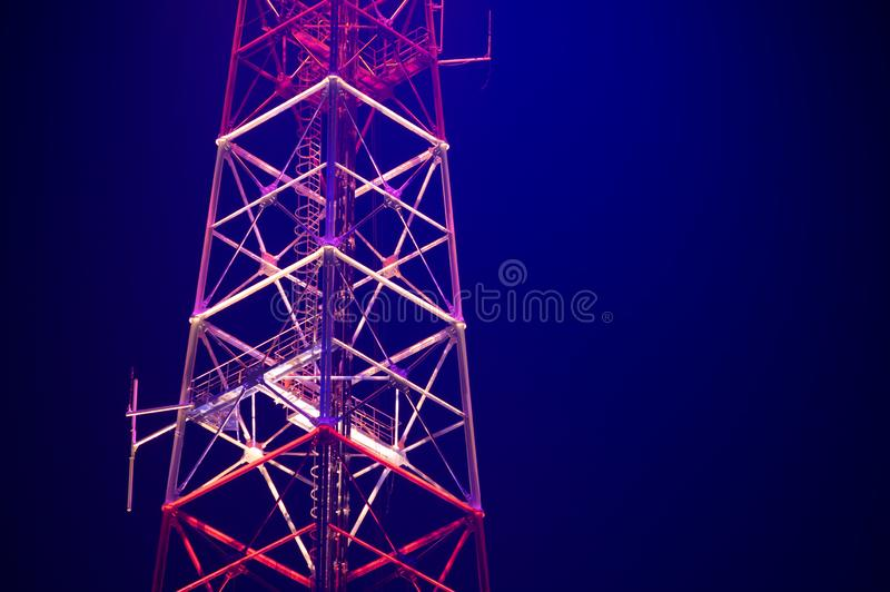 Antenna tower at night in the city royalty free stock image