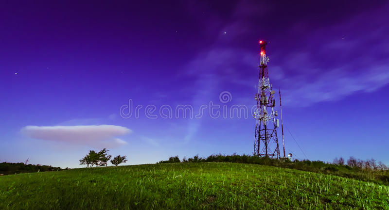Antenna tower. Night shot of the antenna tower on the top of the hill royalty free stock photography