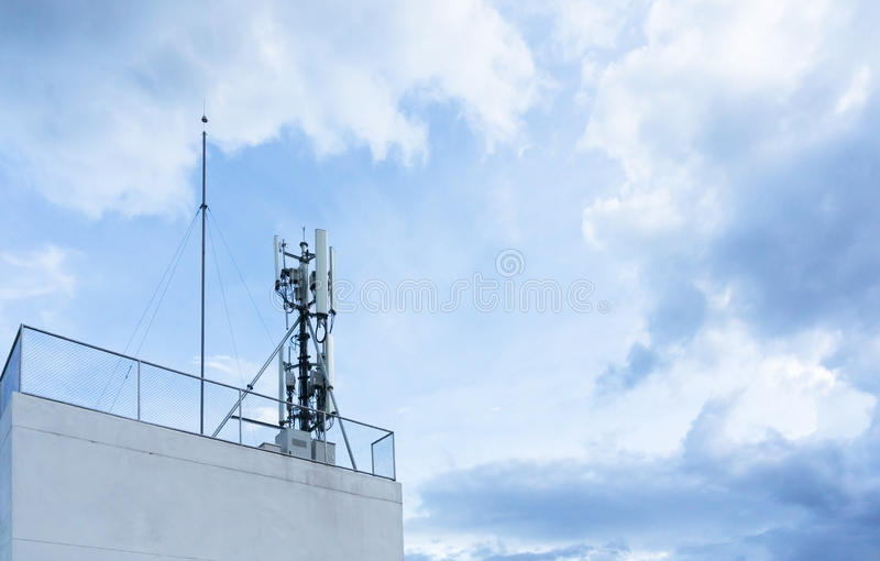 Antenna tower of the radio station on building terrace stock photography
