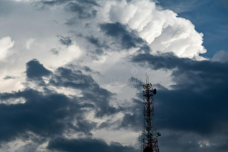 Antenna tower and repeater of Communication with White fluffy clouds in the blue sky background royalty free stock photography