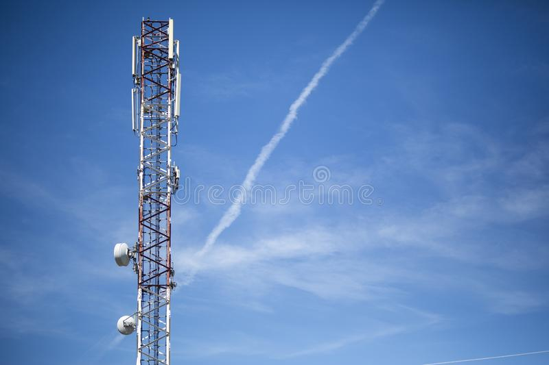 Antenna tower with the sky in the background stock photo