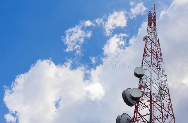 Antenna tower for telecommunication or radio, or microwave on cloud and blue sky background stock images