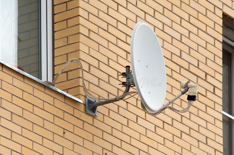 Sattelite antenna on a window stock photos