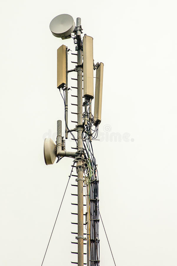 Antennas. A communication pole with many antennas installed stock images