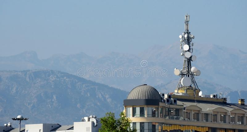 Antenna drums mast, modern building. Mountains, sky. royalty free stock photos