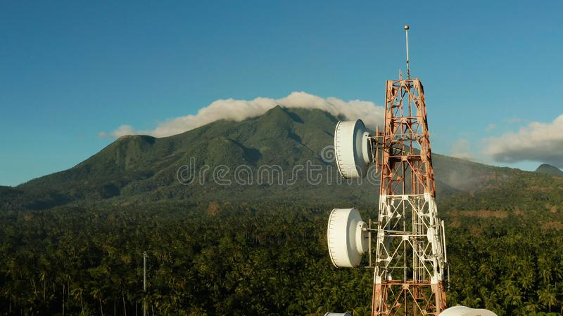 Telecommunication tower, communication antenna in asia. Antennas and microwaves link dishes of mobile phone network and TV transmitter on telecommunication stock images