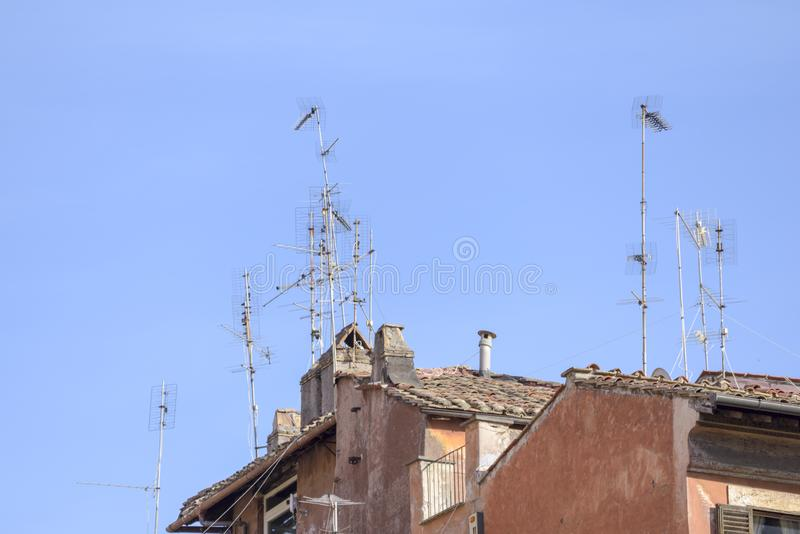Antennas on the roofs of Rome royalty free stock photo