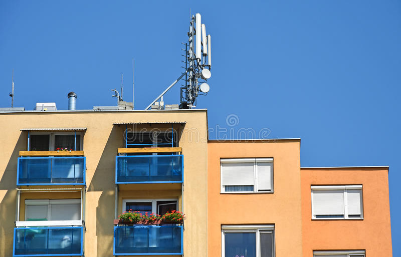 Antennas on the top of an apartment building stock photography
