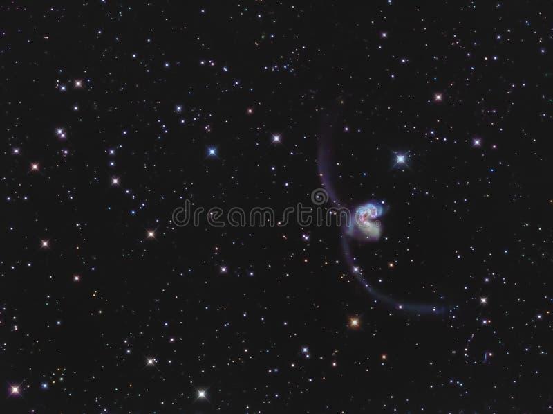 Antennen-Galaxien NGC 4038/4039 im Corvus stockbilder