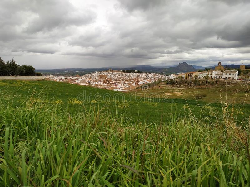 Panorama of Antequera city houses castle fields green cloudy day province of Malaga Spain Andalucia. In 2011, Antequera had a population of 41,854. It covers an royalty free stock photo
