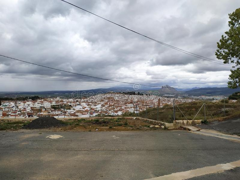 Panorama of Antequera city houses castle fields green cloudy day province of Malaga Spain Andalucia. In 2011, Antequera had a population of 41,854. It covers an royalty free stock image