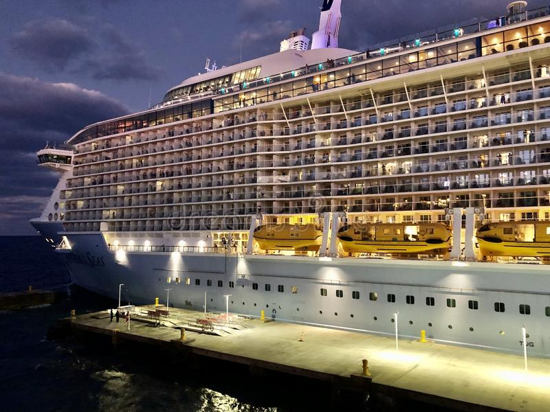 Anthem of the Seas at night. Anthem of the Seas, Royal Caribbean International cruise ship at the Perfect Day at CocoCay, Royal Caribbean Cruise Lines private stock images