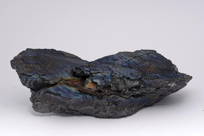 Anthracite coal. A piece of anthracite from a New Zealand mine, known to the miners as rainbow coal or peacock coal. Anthracite is the purest form of coal and it royalty free stock photos