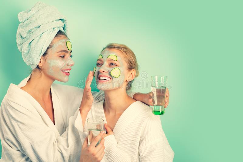 Anti age mask. Stay beautiful. Skin care for all ages. Women having fun cucumber skin mask. Relax concept. Beauty begins. From inside. Spa and wellness. Girls stock images
