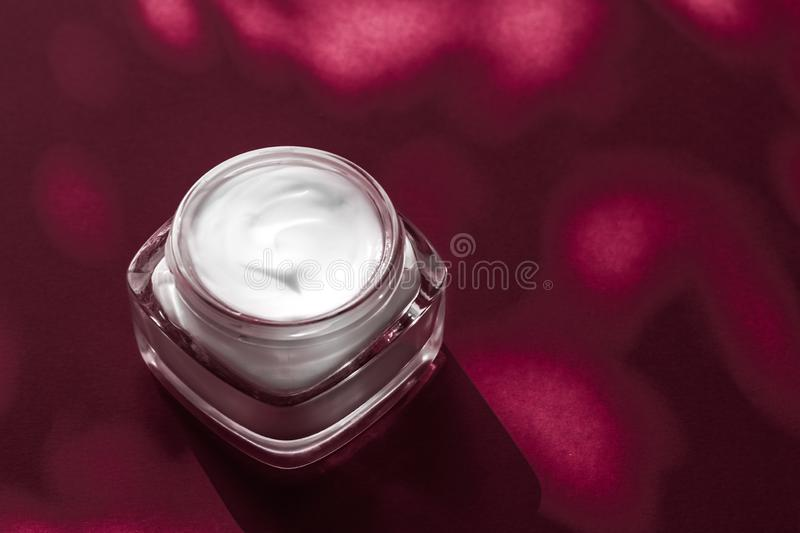 Moisturizing beauty face cream for sensitive skin, luxury spa cosmetic and natural clean skincare product on ruby background. Anti-age moisturizer, luxe stock images