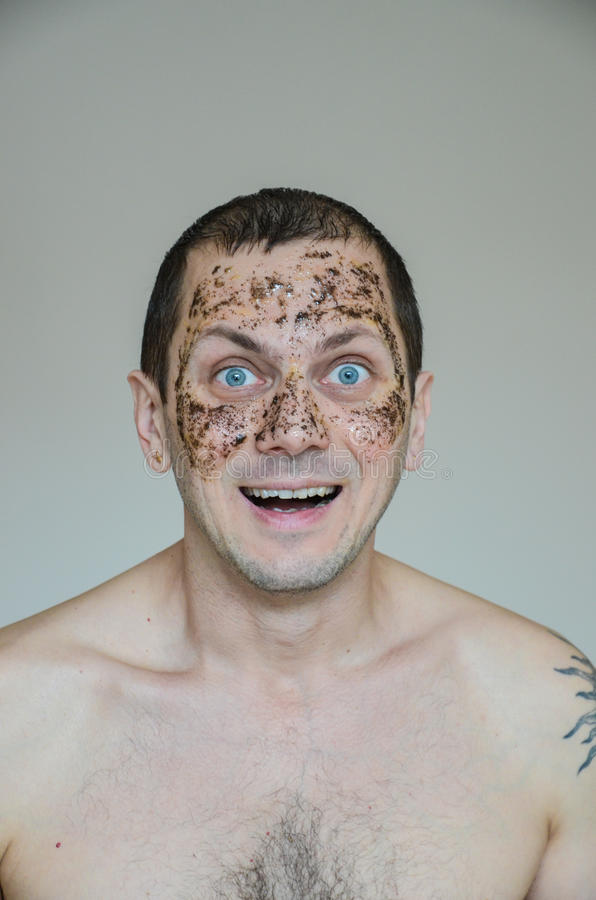 Anti age scrub. Middle-aged man with anti age scrub on his face royalty free stock images