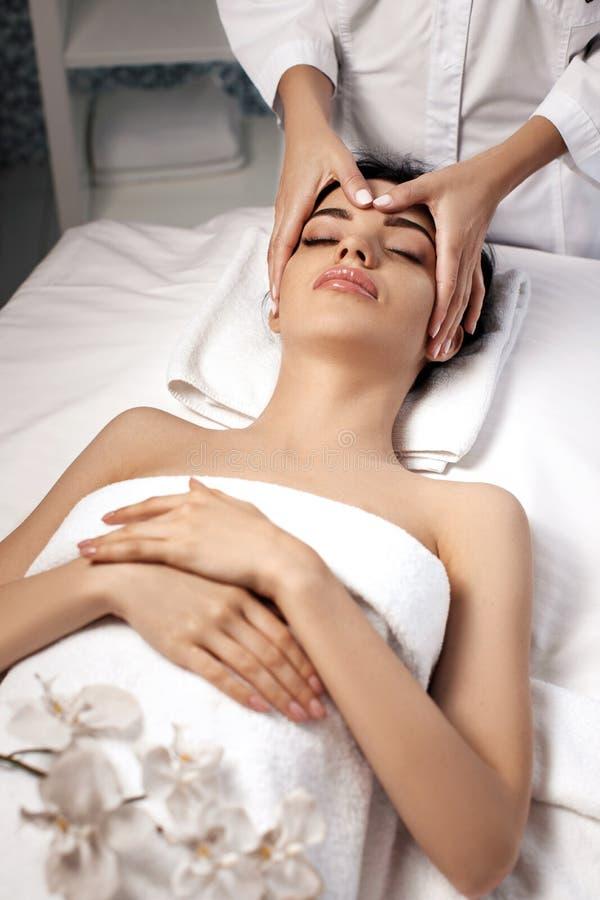 Anti-aging facial massage. stock images