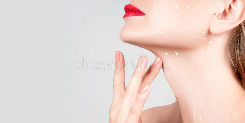 Anti-aging treatment. Beautiful woman neck with massage lines. Anti-aging treatment and face lift. Beautiful woman neck with massage lines or lifting arrows stock photography