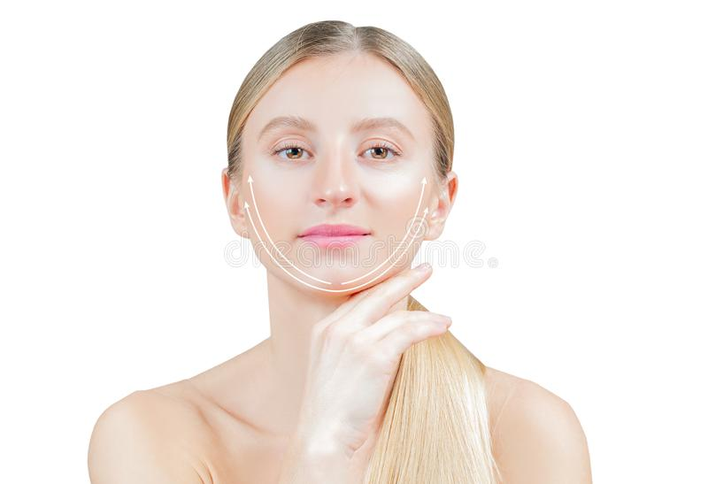 Anti-aging treatment and face lifting. Beautiful woman with perfect skin  with arrows on face royalty free stock photos