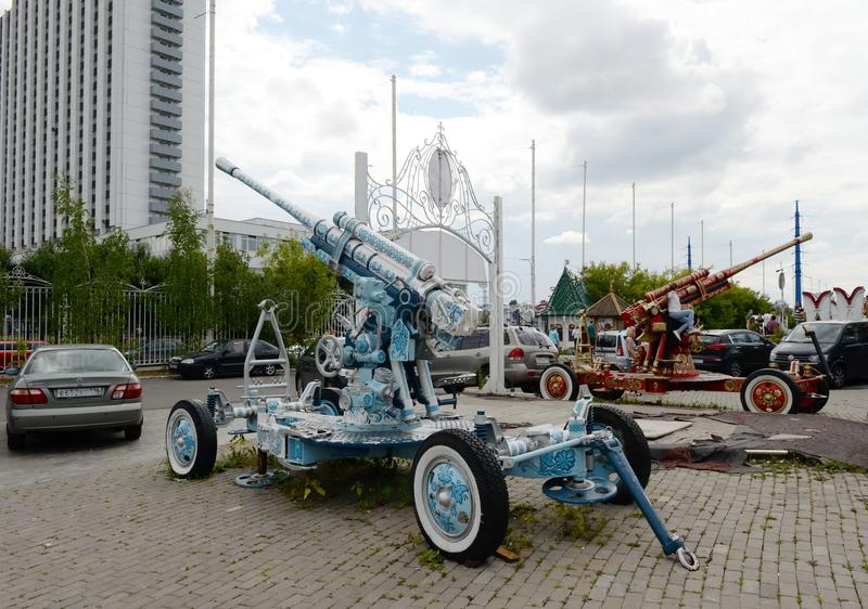 The anti-aircraft guns are painted in the style of an old Russian decorative painting by the Izmaylovsky Kremlin in Moscow. MOSCOW, RUSSIA JULY 7, 2018: The stock images