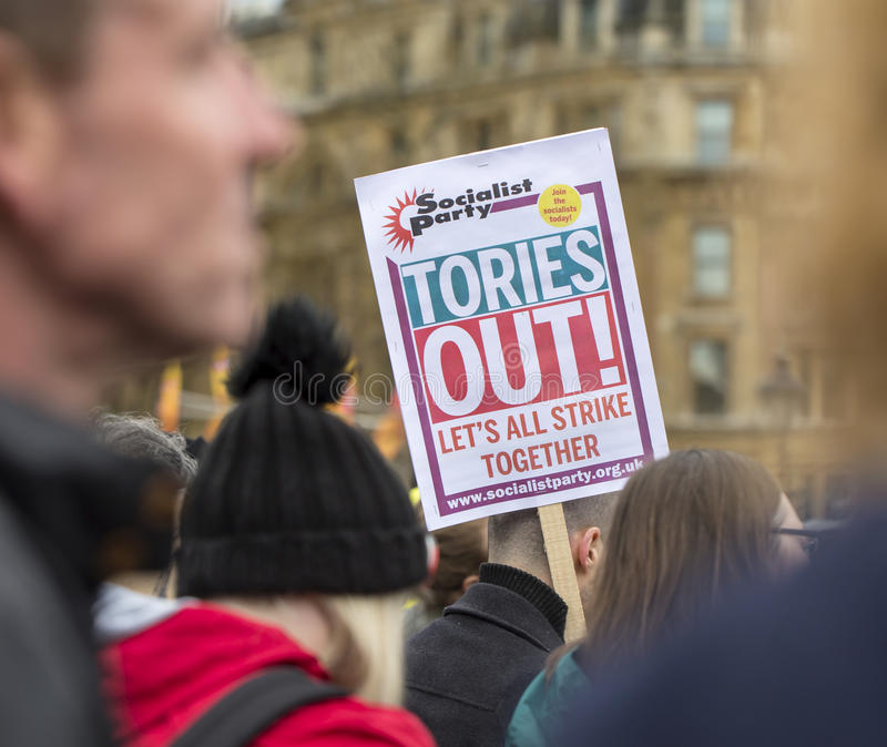 Anti-Austerity March. All focus in on the sign by the Socialist Party that we should strike to get rid of the present Conservative Government. london royalty free stock photography