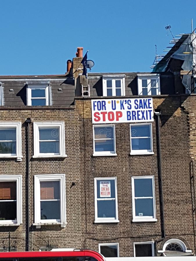 Anti-Brexit banner - For *U*K`s sake, Stop Brexit - at the top of a building in London. Anti-Brexit banner - For *U*K`s sake, Stop Brexit - at the top of a royalty free stock photo