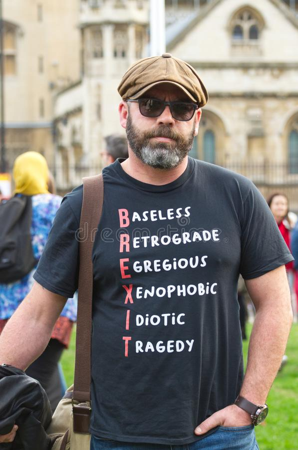 "An anti Brexit demonstrator / protester in London on October 19 2019. A pro remain anti Brexit protestor in London with a tee shirt that reads ""Baseless stock photo"