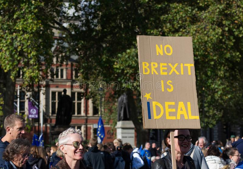 "Anti Brexit demonstrators / protesters in London on October 19 2019. Pro remain anti Brexit protestors in London with a board that reads ""No Brexit is I royalty free stock photo"