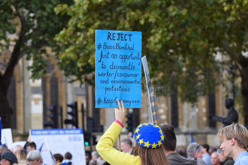 "Anti Brexit demonstrators / protesters in London on October 19 2019. Pro remain anti Brexit protestors in London with a board that reads ""Reject Bozos Bum royalty free stock photos"
