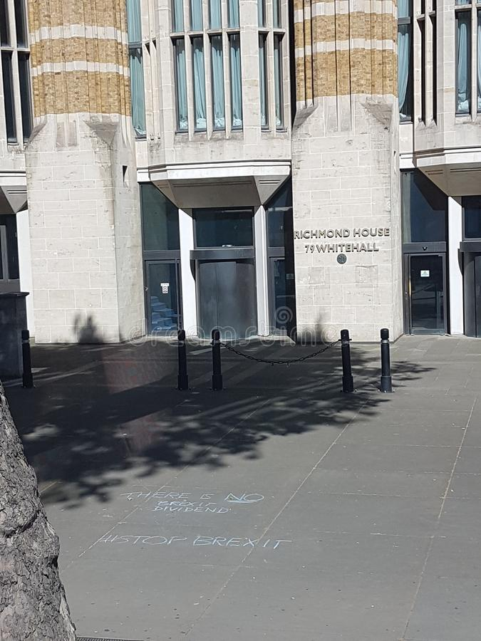 Anti-Brexit message - Stop Brexit - written with chalk in front of Ministry of Health. Anti-Brexit message - Stop Brexit - written with chalk on the pavement in stock images