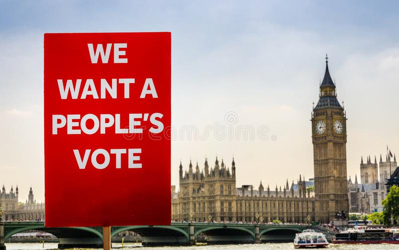 Anti-Brexit placard composite at Westminster, London, UK. Placard with anti-Brexit message with Big Ben and Houses of Parliament, London in background royalty free stock photo