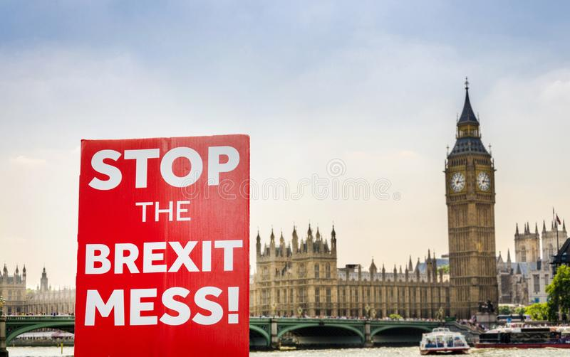 Anti-Brexit placard composite at Westminster, London, UK. Placard with anti-Brexit message with Big Ben and Houses of Parliament, London in background stock photo