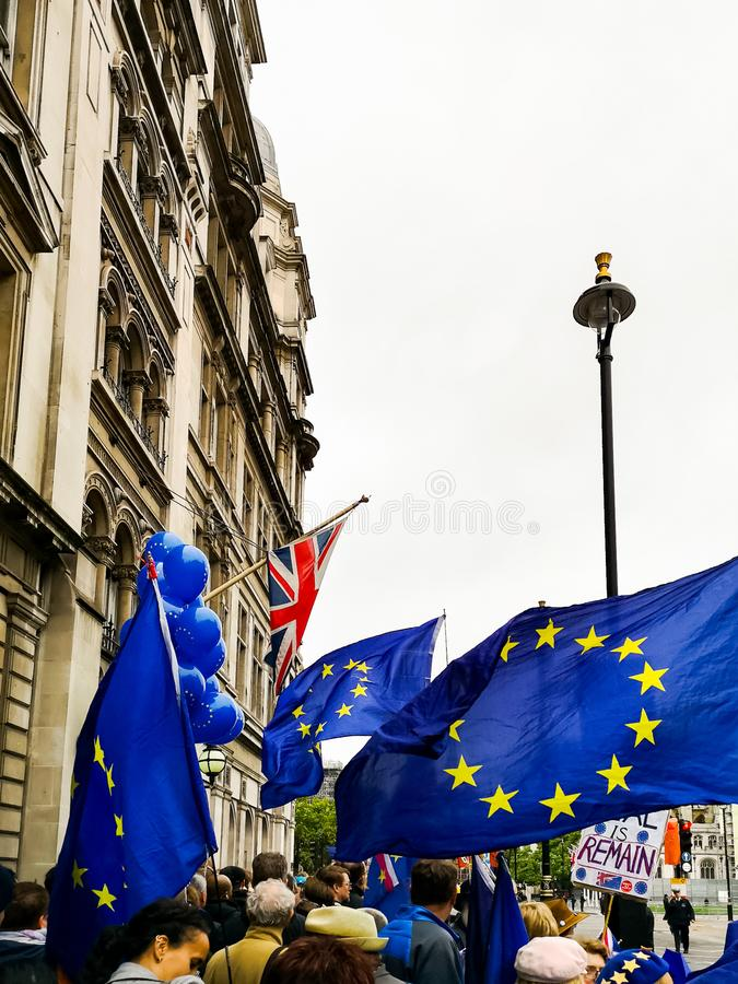 Anti-Brexit protest in London near Parliament. London, UK - 14 October, 2019: Anti-Brexit protest in London near Parliament. European Union and British Union royalty free stock images