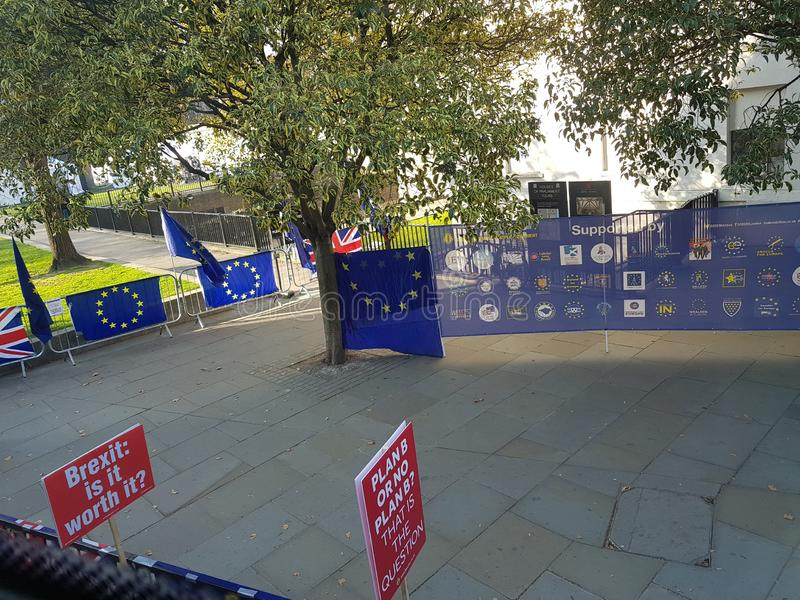 Anti-Brexit protest with anti-Brexit posters and flags. Anti-Brexit protest with anti-Brexit posters and flags in Parliament Square, Westminster, London royalty free stock image