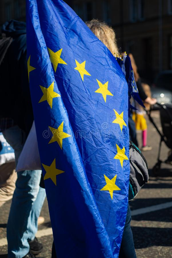 Anti Brexit Protester Carries a European Union Flag at a Pro EU March in Scotland. Protester Carries a European Union Flag at a Pro EU Anti Brexit March Through royalty free stock images