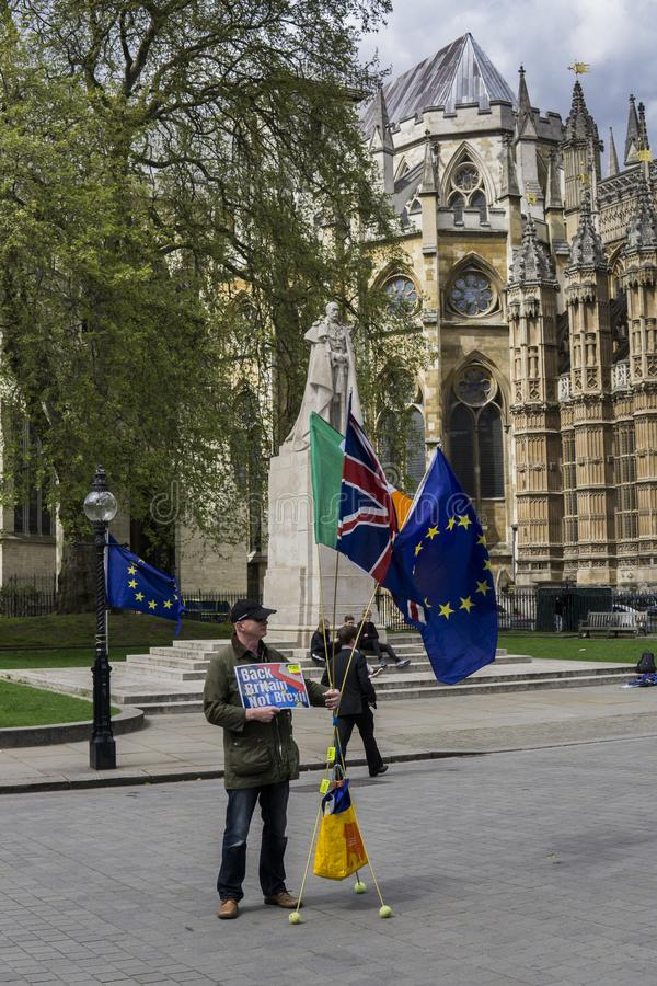 Anti-Brexit protester in London. Anti-Brexit protester outside the Houses of Parliament in London in April 2018 stock photography