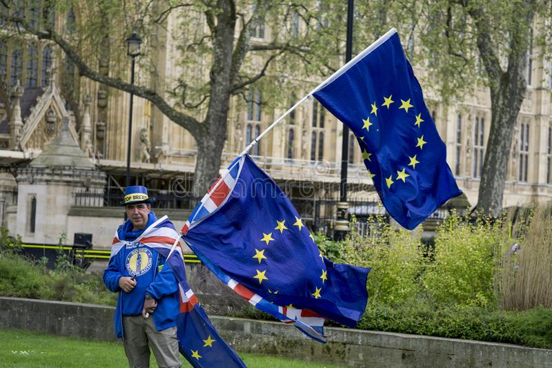 Anti-Brexit protester in London. Anti-Brexit protester outside the Houses of Parliament in London in April 2018 royalty free stock photo
